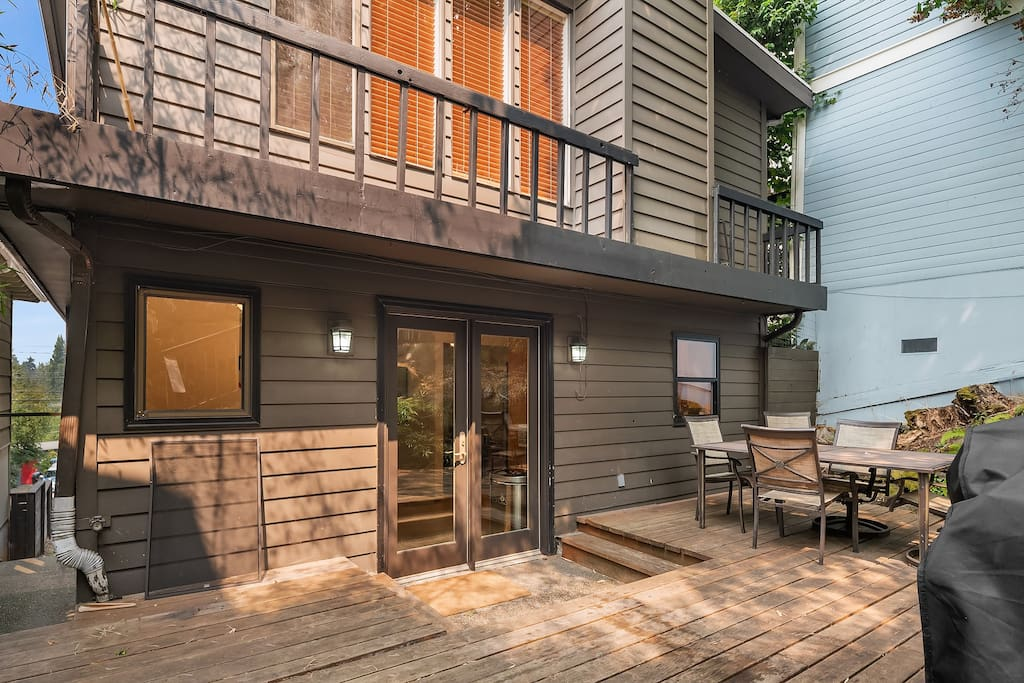The large back deck of the home is an urban oasis.