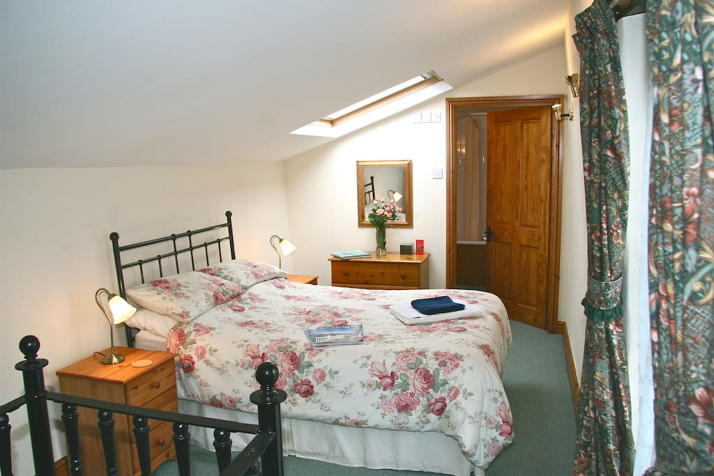 Double bedroom with all linen provided. Full en-suite bathroom, bath with power shower over, toilet and hand basin.