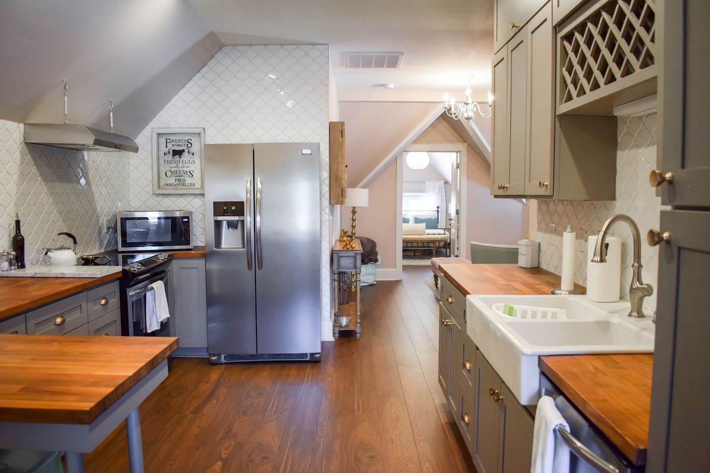 Kitchen with refrigerator, oven, stove, microwave and coffee maker. Pots and pans provided