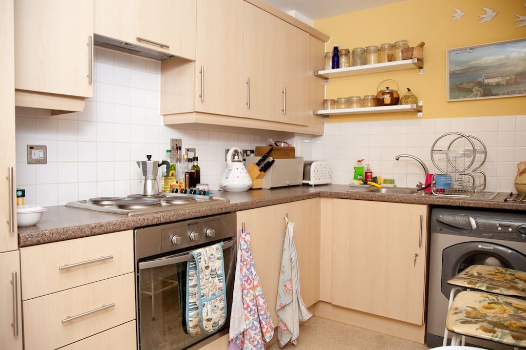kitchen with oven and washing machine..all mod cons available