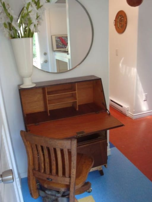 fold down walnut desk and oak chair make for a quiet  little work alcove in foyer