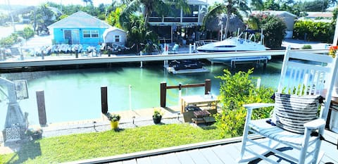 Canal Front Paradise Entire Home w/golf cart & Spa