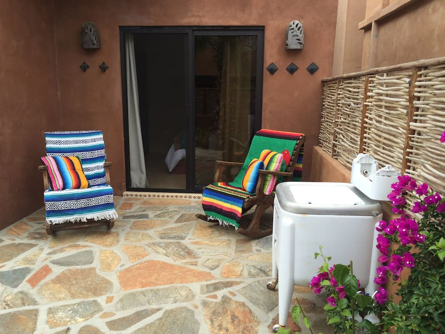 Guest room opens to main patio