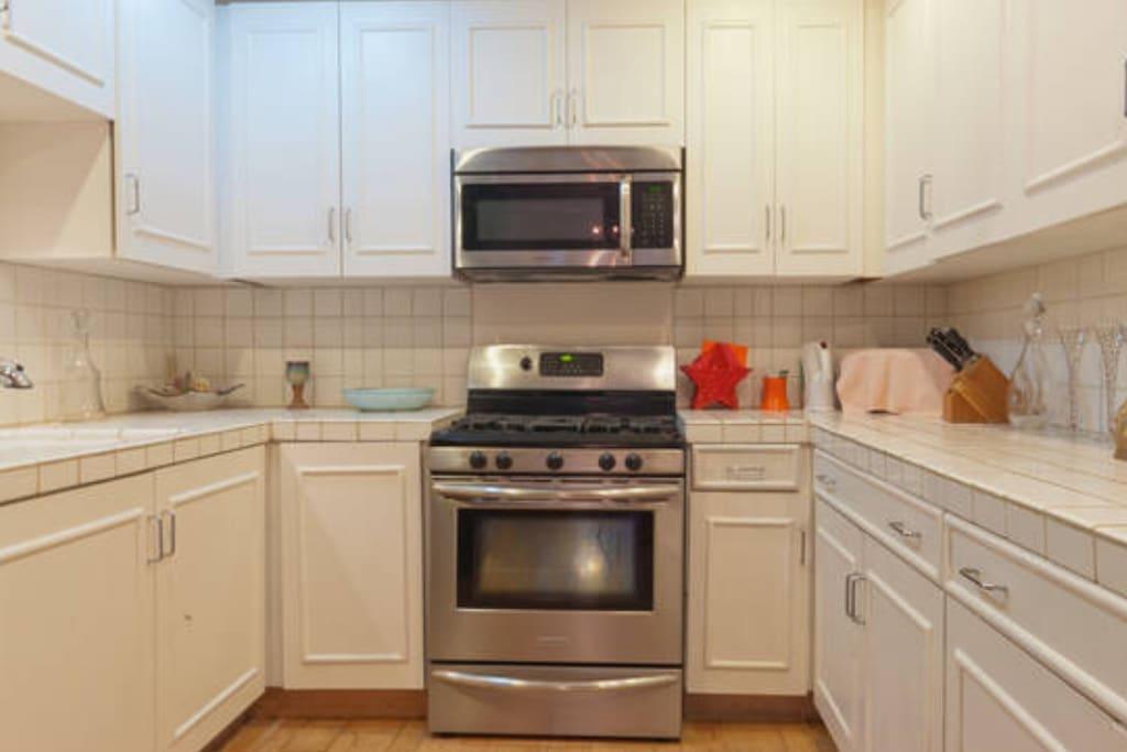 A sleek and modern kitchen awaits you.