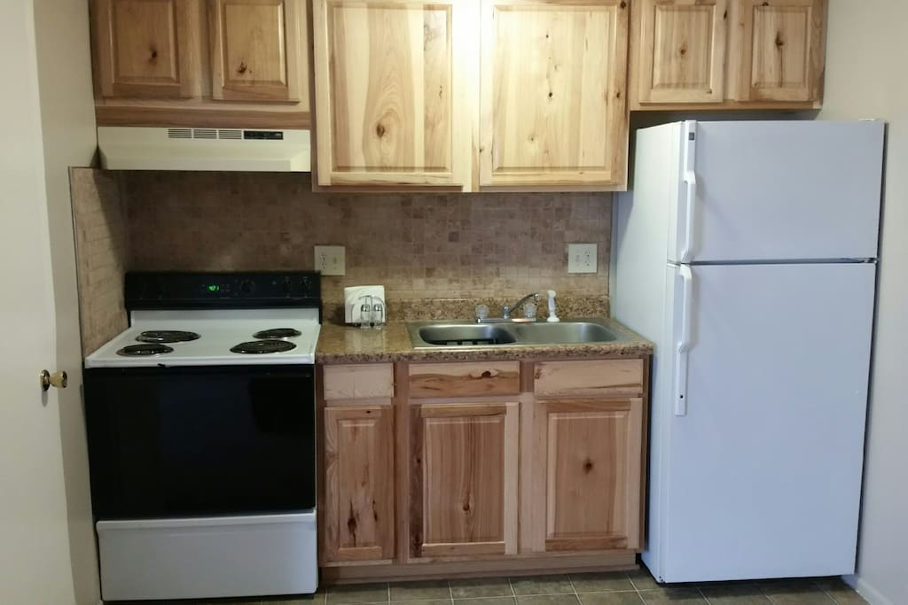 Cute kitchen with new hickory cabinets and newly updated flooring