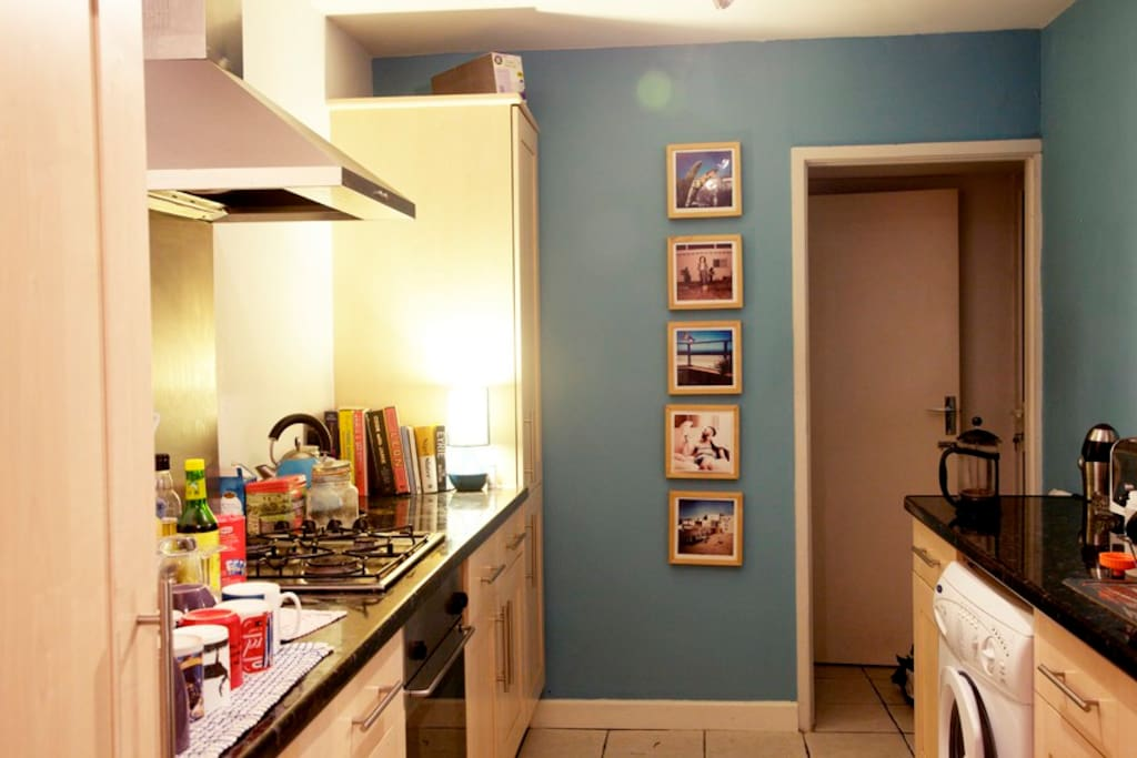 Kitchen with all utensils, a load of cookery books and coffee grinder included!