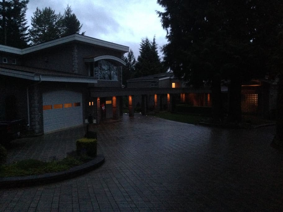 Driveway and house at dusk