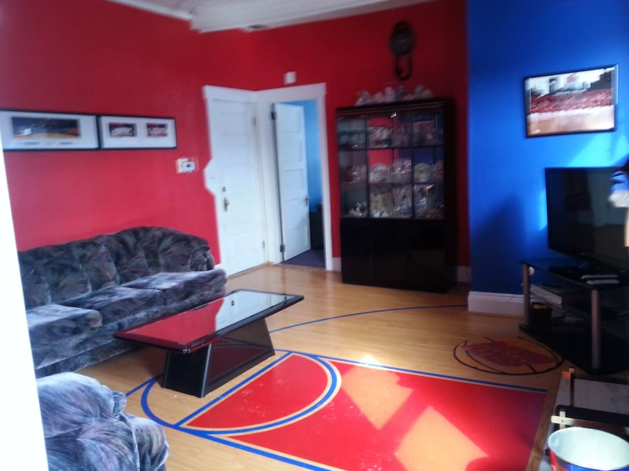 This is why we call it the Flyer Fanatic Apartment--your TV room is decorated in University of Dayton colors and  includes a 2/5 scale half-court basketball floor