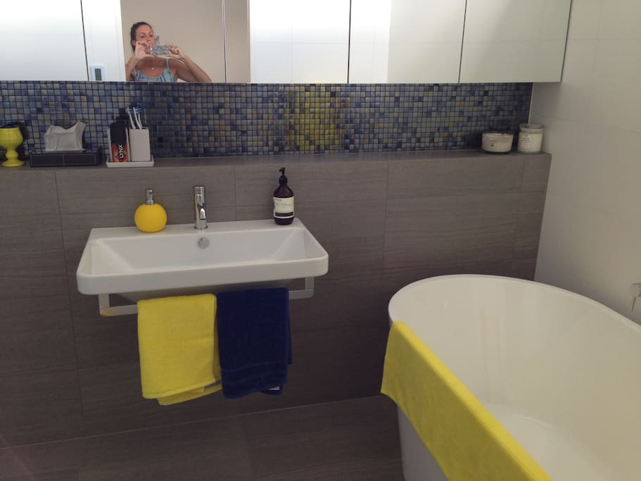 kids bathroom with shower,bath,toilet,lge sink and in floor heating