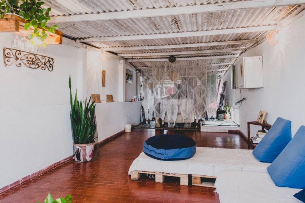 We love this place! This is our roof deck, where you have sofas, a hammock and even a mini-kitchen. We have tons of plants up here as well.