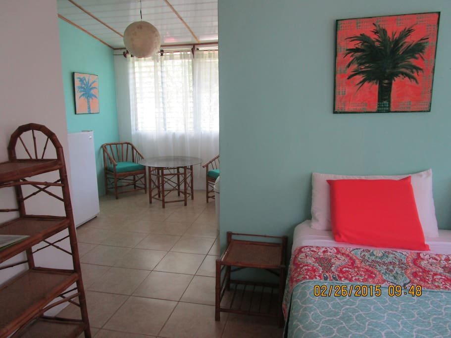 Private entrance, private bathroom, refrigerator, coffee pot, toaster oven, dining table and chairs.