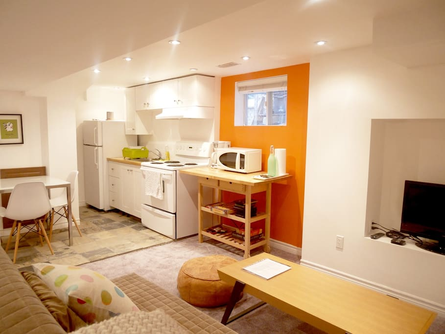 A bright and cheerful, open concept living-dining area.