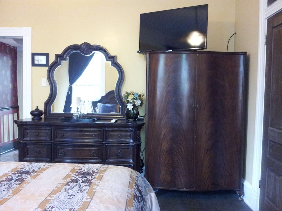 "Antique mahogany armoire and 40"" high-def TV are features of the Azalea Room."