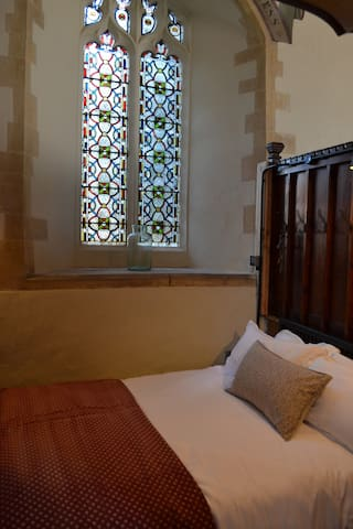 the second bedroom is located in the old vestry and has a double bed