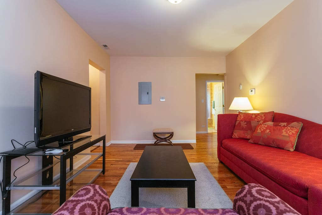 Living Room:  My condo has an ample sized living room with plenty of natural light.  The living room sofa converts into a bed.  Feel free to relax from a full day of touring Chicago and watch your favorite program on the 42'  television.