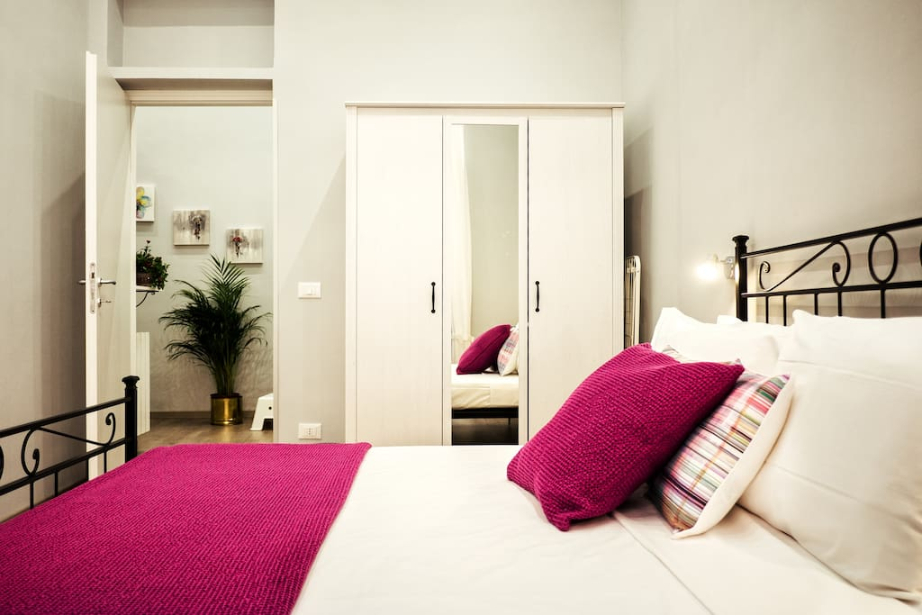 the first bedroom with the wardrobe and AC system