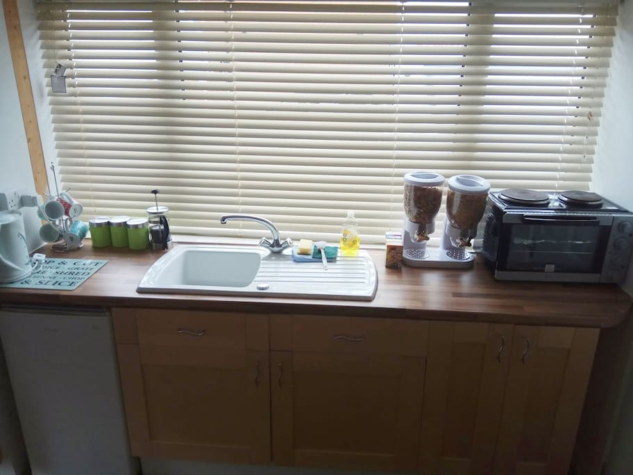 Kitchen area with free cereals,tea and filter coffee,mini oven, Microwave,toaster,kettle and fridge.