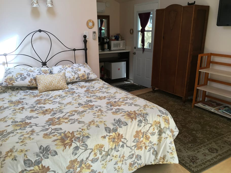 Queen size bed, non cluttered, armoir for clothing.