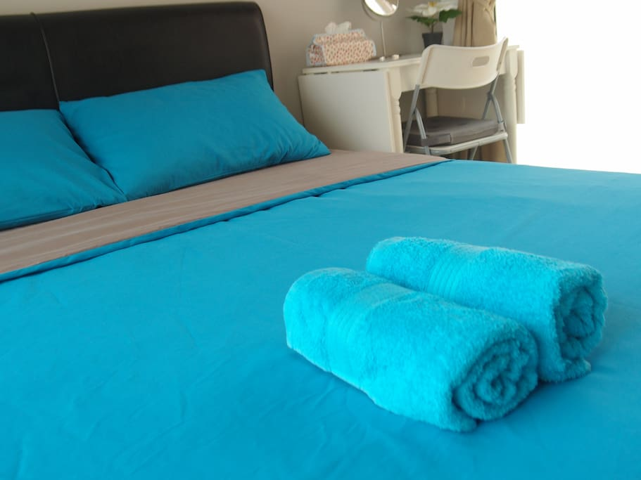 Lush Queen Bed with Towel