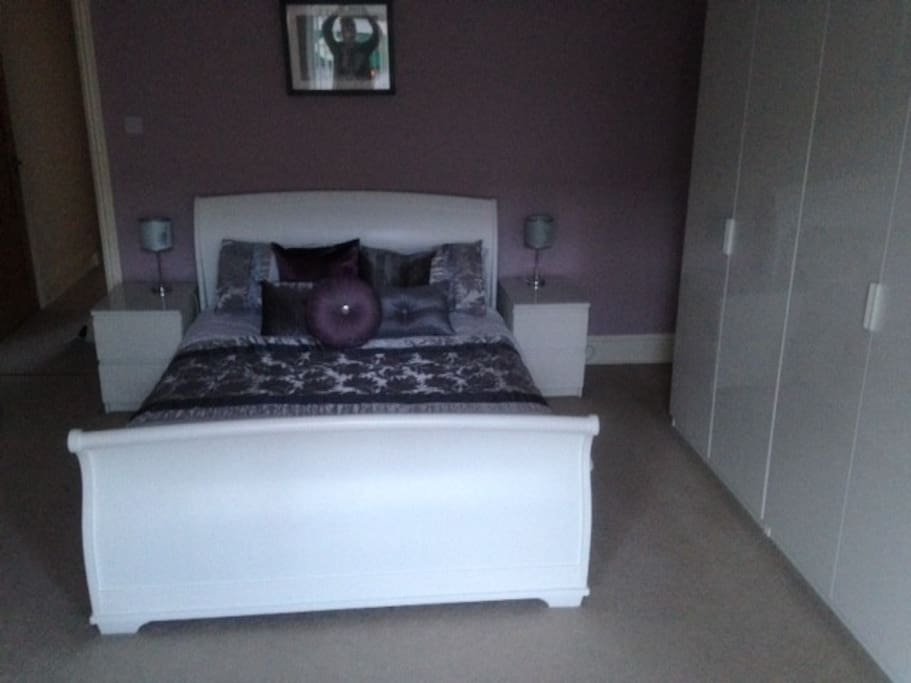 Master Bedroom with kingsize bed and fitted wardrobes.