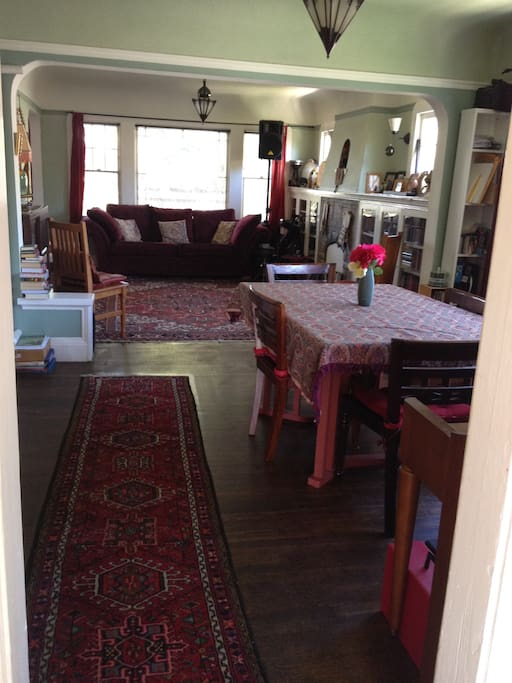 Living/dining area with Persian carpets and Moroccan lamps