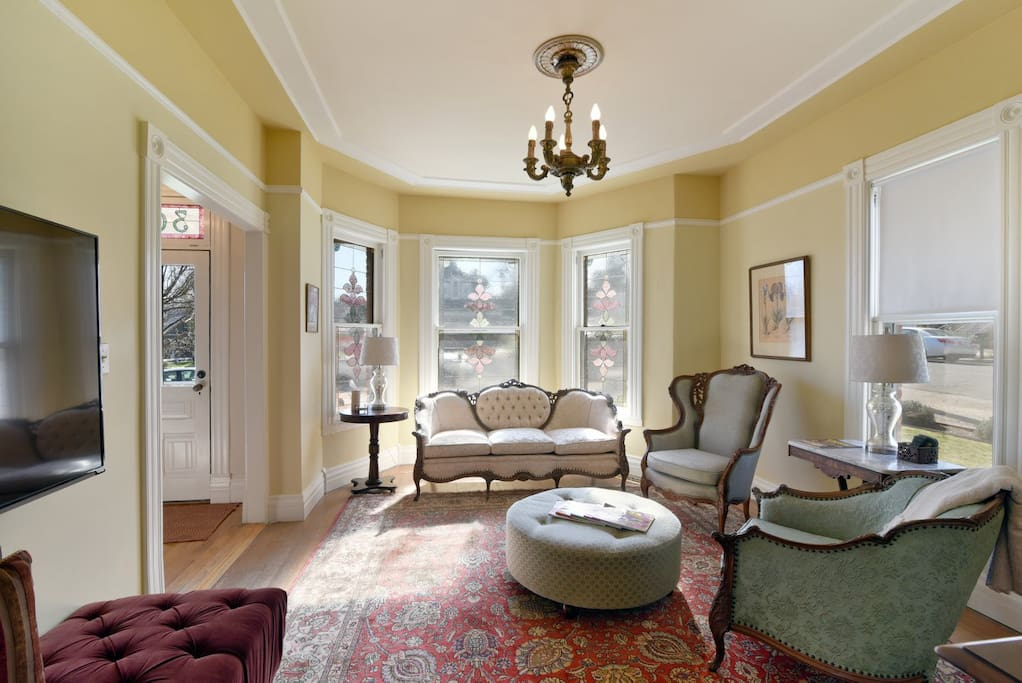 The beautiful front living area reflects the time period of the home