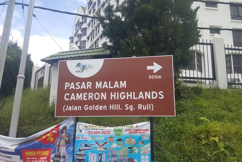 "Follow this signboard. The apartment is just in front of the ""Pasar Malam"""