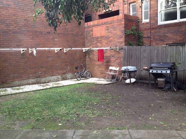 Shared backyard and own washing machine! Soap also included!!