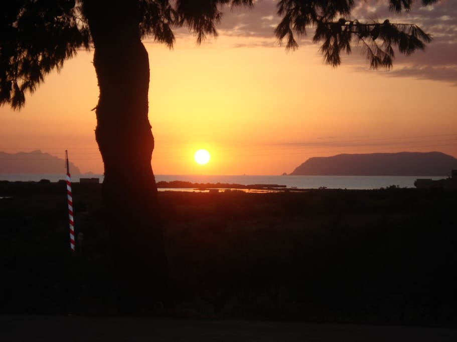 the view from the terrace at sunset with the Egadi's island on the background