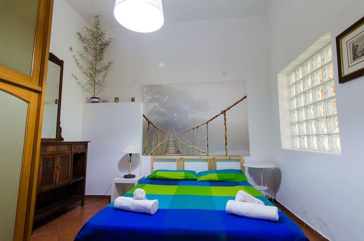 Bedroom 4 with double bed Villa del Filosofo by SunTripSicily.com