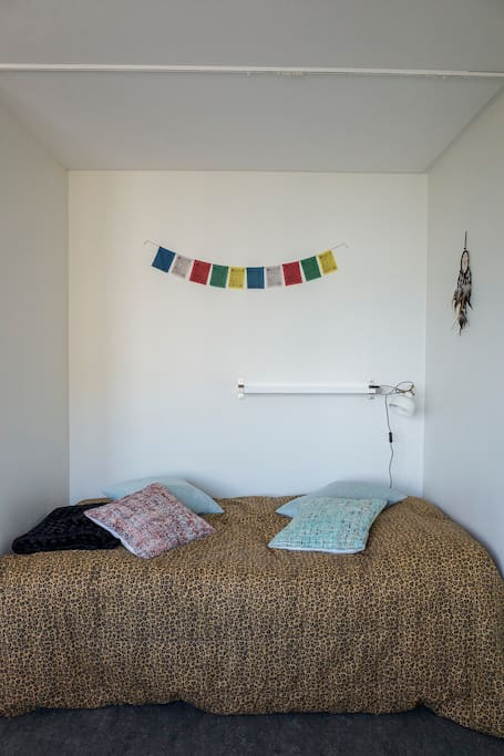 The 120cm very comfy bed, with shelf and lamp above.