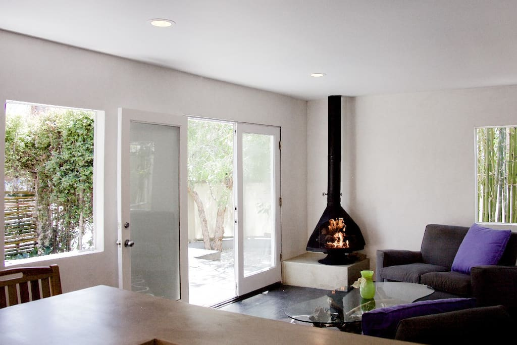This indoor outdoor domain is heated by what else - a vintage Malm gas fireplace.
