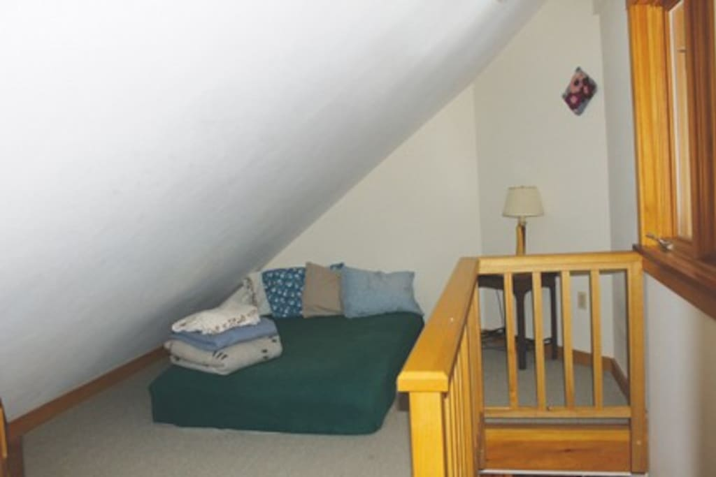 Upstairs Family Room - Double size Bed.