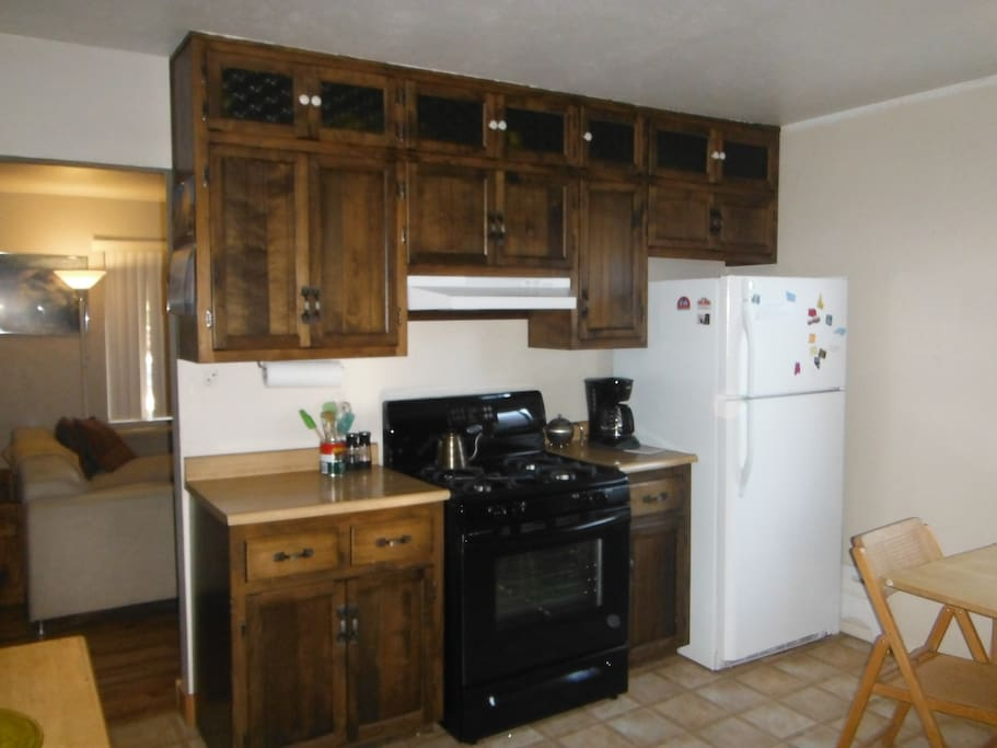 Kitchen with brand new gas range, full size refrigerator