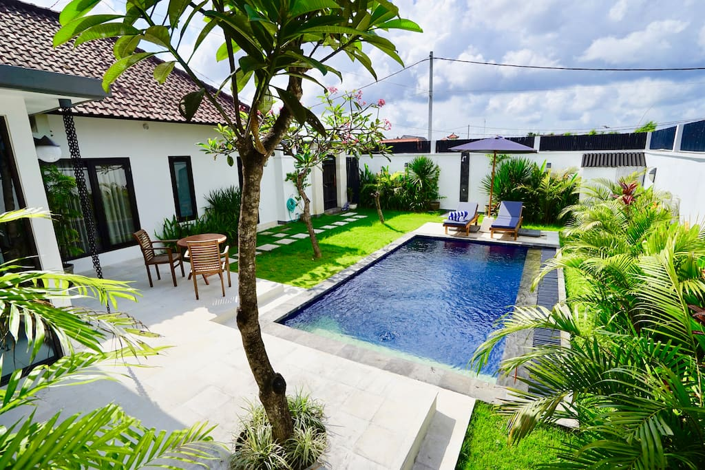 Beautiful bright and breezy private garden with terrace table and chairs, pool, sun umbrella and loungers.