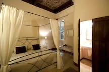 Four poster bed in a spacious room.