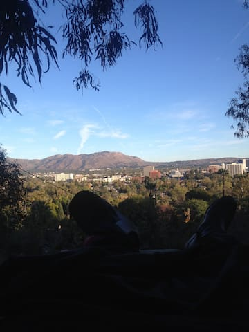 view of city and San Bernardino mountains from private deck in back yard.
