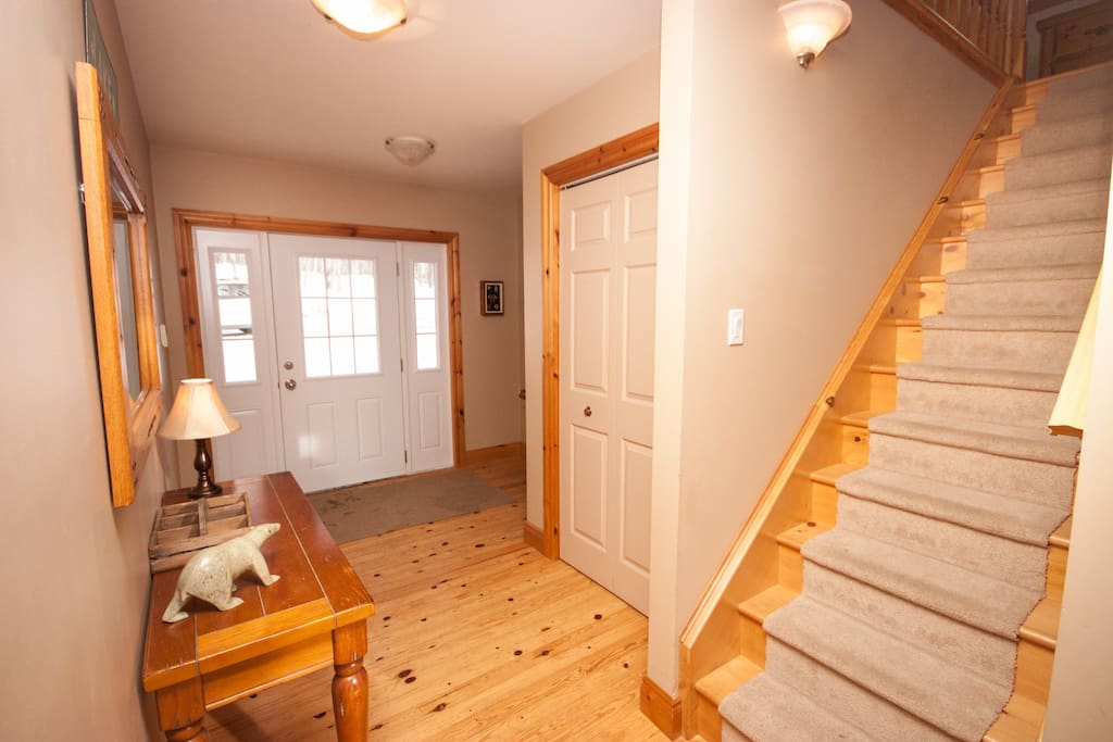 Front entry hall. To the right is the laundry/mud room and up the stairs is the master loft.