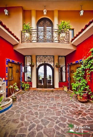 Entry way & the doors for entrance to two bedrooms