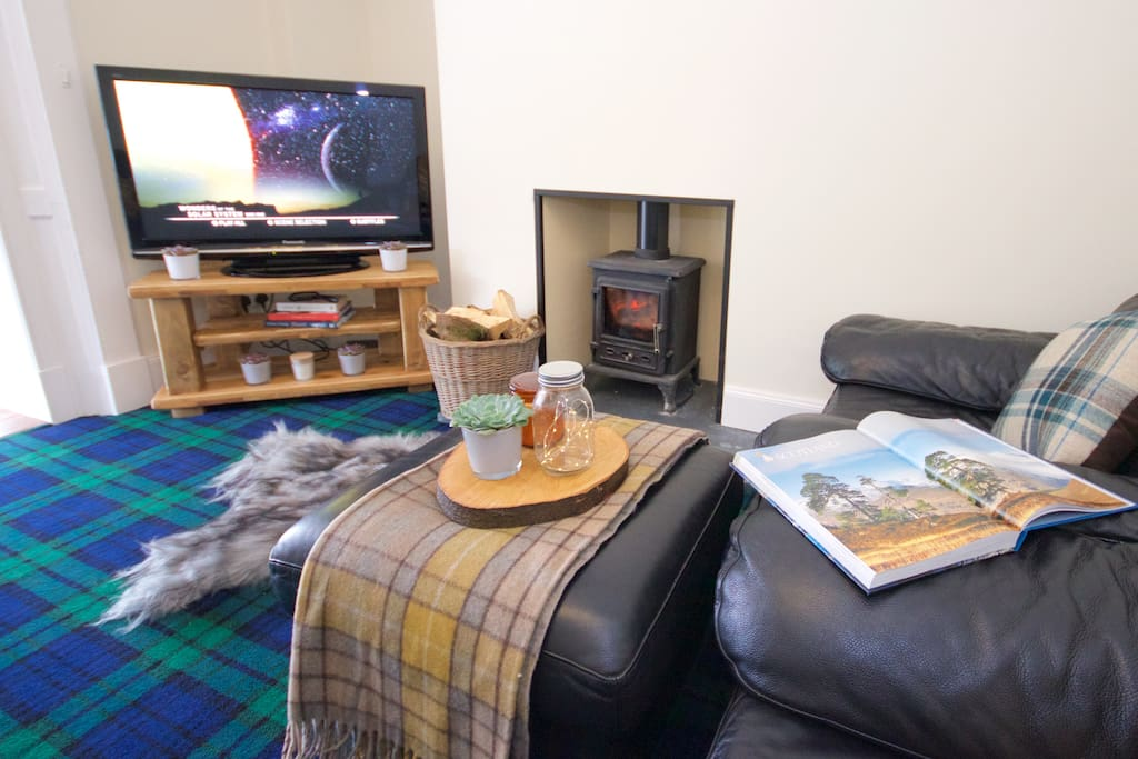 Living Room - Relax here with a crackling log fire, big screen TV, Blu Ray dvds, and even a Netflix account