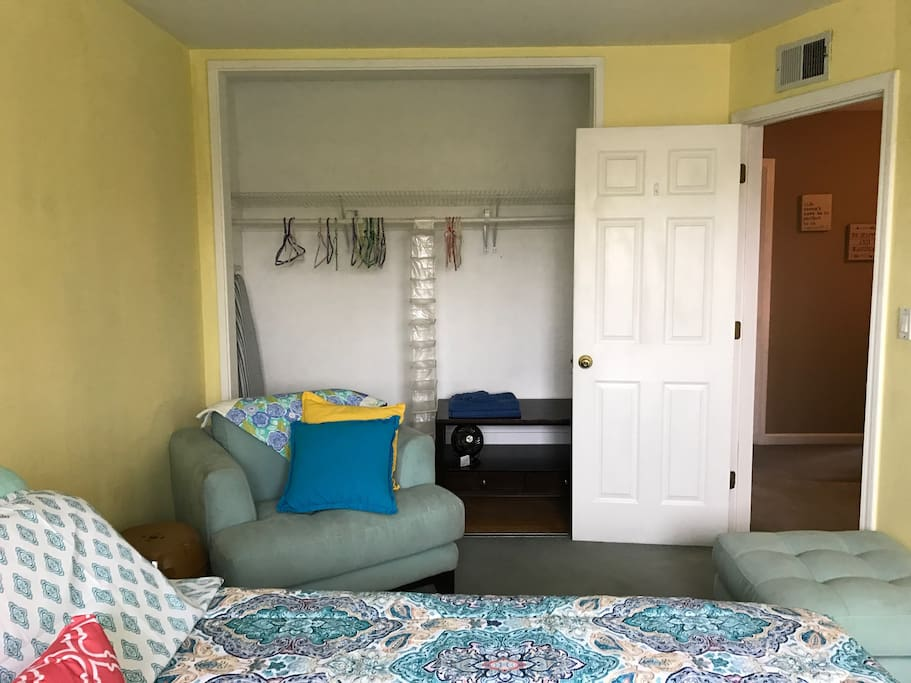 Large closet with ironing board. Comfy chair with ottoman if want to lounge and read!