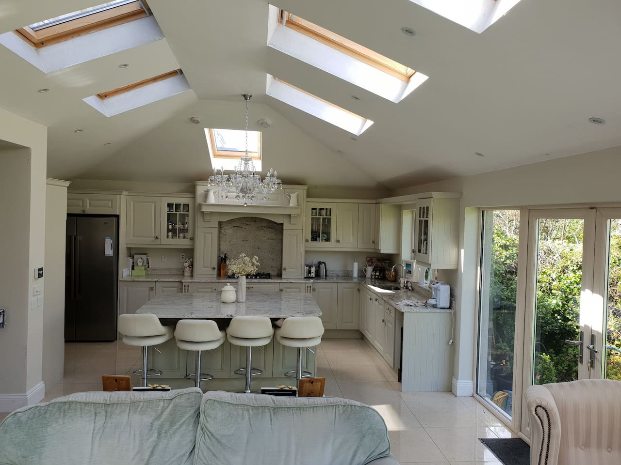 Attractive open plan kitchen dining area with large island to enjoy socialising during your stay.