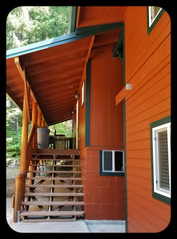 """This is the second set of stairs which leads up to the """"Cow"""" unit.  Cow has a private smaller deck area which has its own private propane BBQ."""