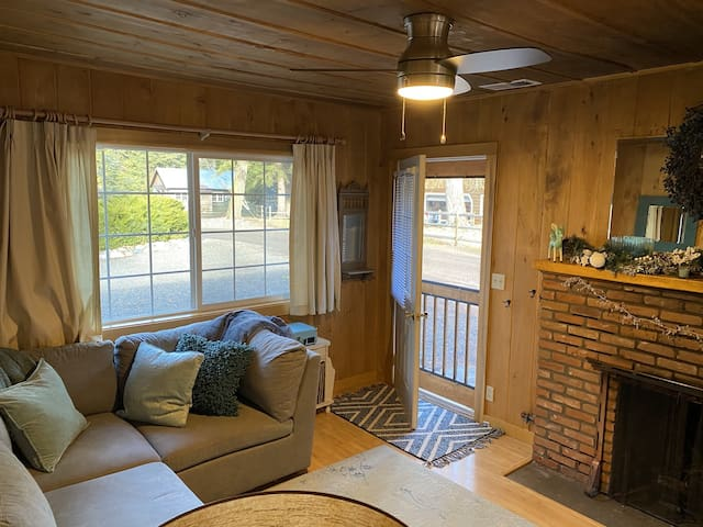 Adorable little 2 bedroom 1 bath cabin has a bigl back deck perfect for your family bbq!