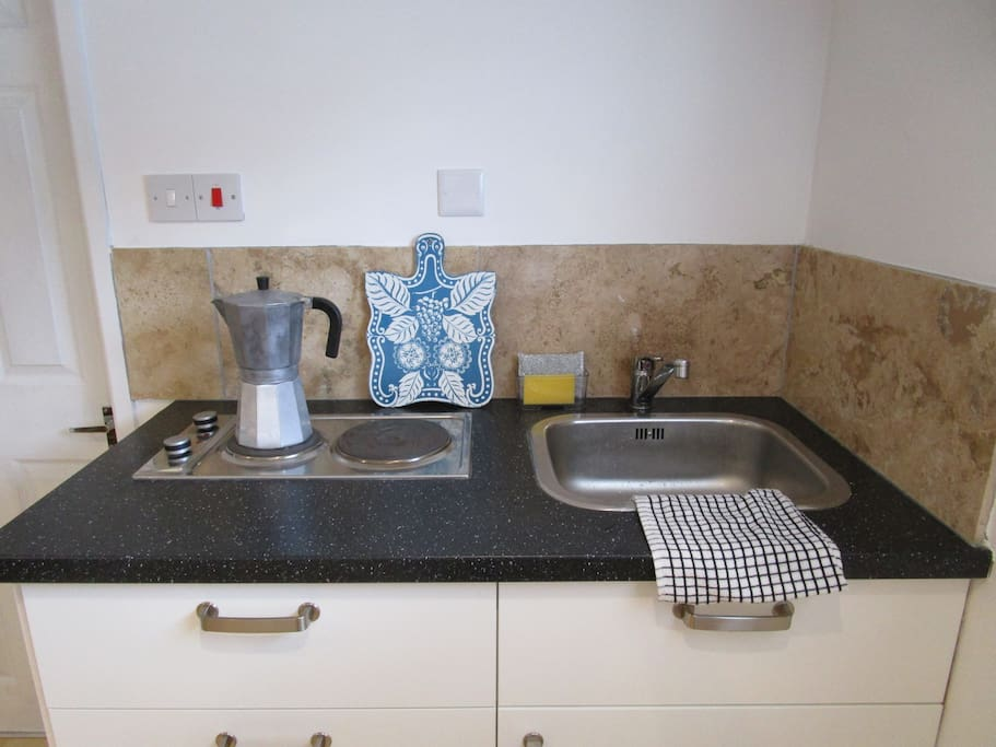 Kitchenette with electric hob and sink