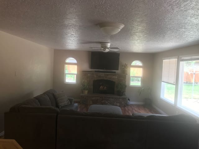 Living room-wood burning fireplace, large tv with Hulu or Netflix. Large comfortable sectional!