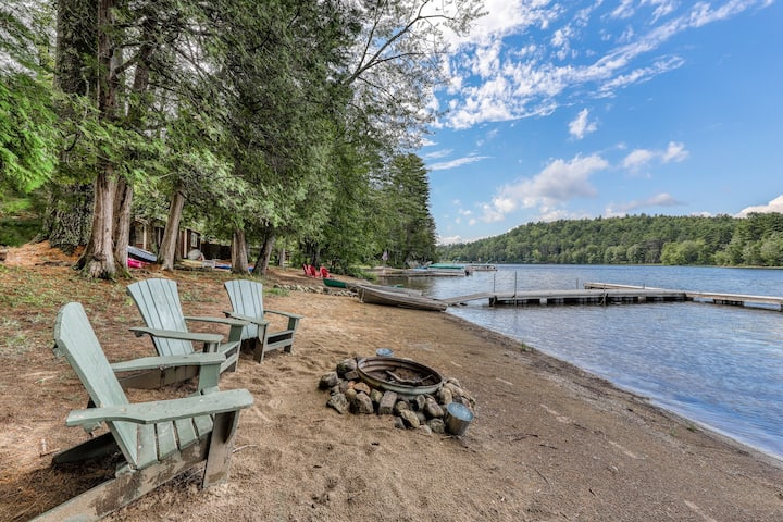 Lakefront cottage w/ large dock, seasonal firepit, & sandy beach