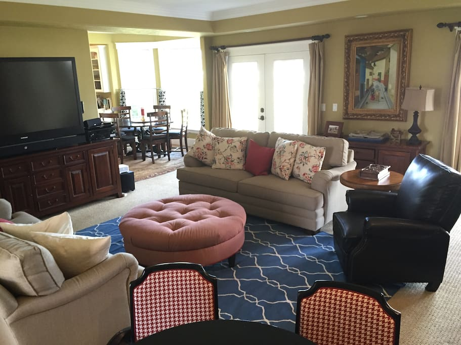 Family room with big screen TV and french doors to back patio/BBQ area.