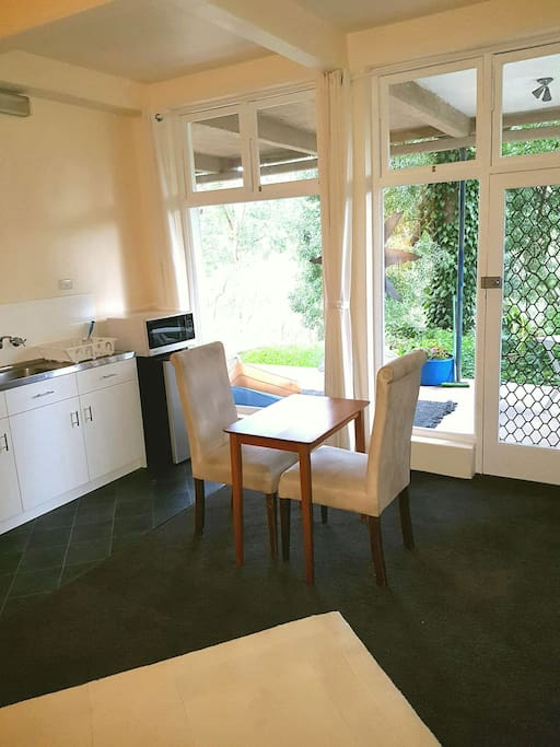 Kitchenette and dining area with garden view
