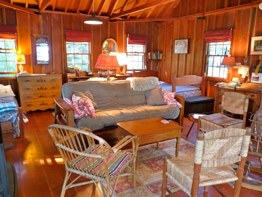 Great room with cozy woodstove/ fireplace & gorgeous ocean views